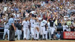 Derek Jeter celebrates with teammates after single home run 3000th hit./AP Photo